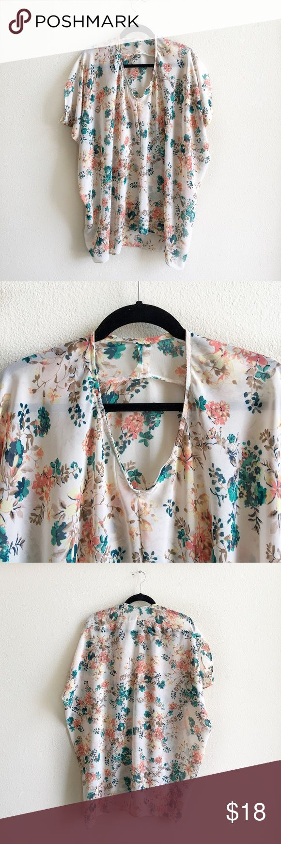 """💥New Listing! Flowy Floral Top Gorgeous semi sheer floral print • handmade with some minor flaws- like the neckline is a bit bubbly (2nd picture) but it isn't noticeable when worn • batwing sleeves • versatile top can be used as a blouse, swimsuit coverup, etc. • bust is 32"""" flat and is 35.5"""" long • can work for a variety of sizes Tops"""