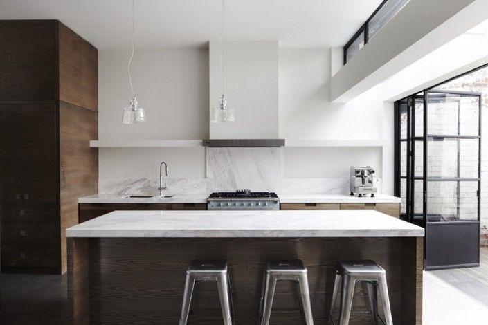 black steel door with marble kitchen. rangehood and shelf