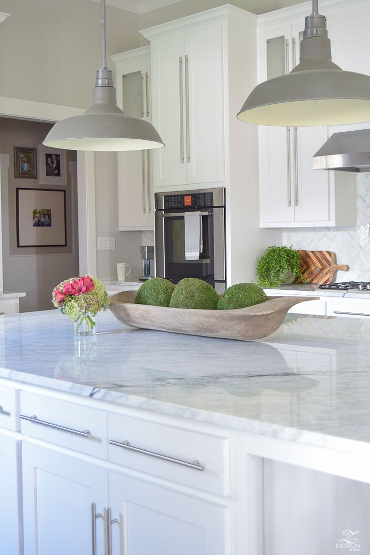 carrara-marble-kitchen-island-bread-bowl-moss-balls-white-farmhouse-kitchen-herringbone-backsplash-2