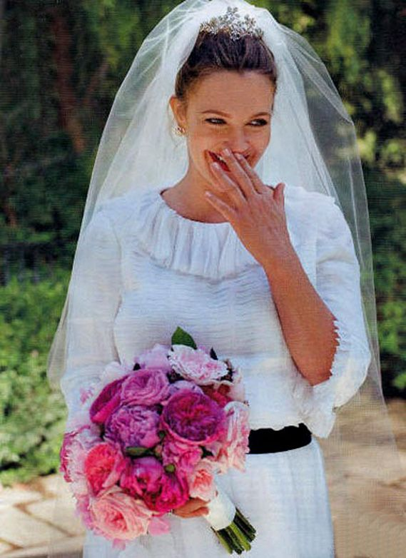 Drew Barrymore in her Chanel wedding dress at her Montecito, California home.