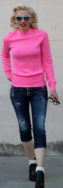 pink sweater and blue capri jeans