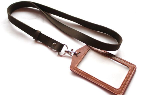 Leather lanyard made with real brown leather high quality by myself. Lanyard with id holder is a very necessary and multifunctional thing in our modern world. lanyard with badge holder (id holder made with faux leather) and lanyard made with real leather This cute lanyard ( id badge lanyard ) can be cool gift for him or for her. Size : 0.59 inches (1.5cm) wide. 18.5 inches (47cm) length of leather. 19.6 inches (50cm) length including silver tone hook.  ! Lanyard and ID badge have а little…