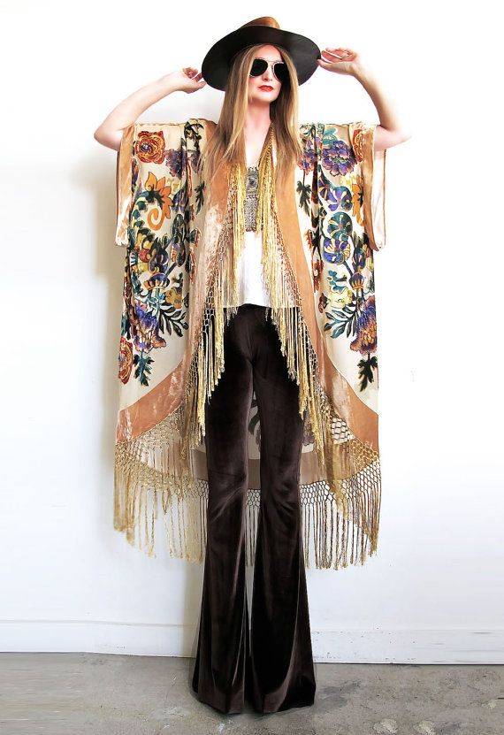Stunning vintage inspired kimono. Incredible floral motif on beautiful carmel colored velvet burnout.  Gorgeous silk fishnet fringe starts at front neckline and goes all around bottom hem. An oval shaped shawl was used to make this and then pleats were added to shoulder for a stunning