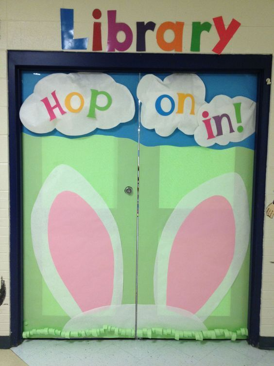 Hop on in to the library - Easter door display idea with bunny ears