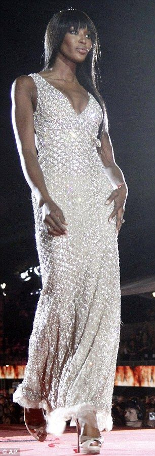 An old pro: Naomi Campbell walks the runway at the 20th Life Ball in a stunning floor length gown