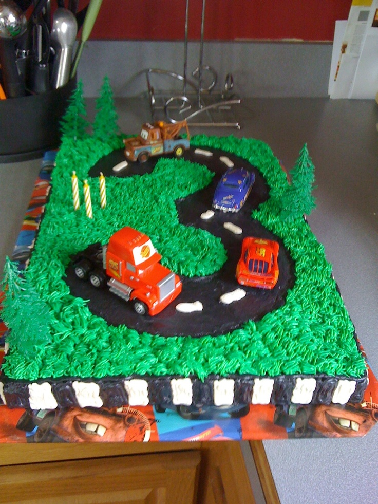 Cars cake made for three year old's birthday by Frosted and Iced by Price.  Find me on facebook