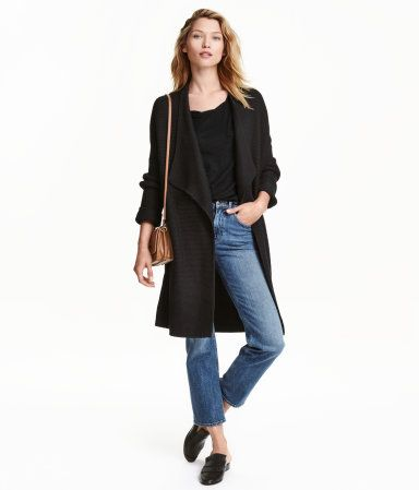 Black. Textured-knit cardigan in a soft cotton blend. Draped shawl collar, dropped shoulders, and long sleeves with sewn cuffs. No buttons.