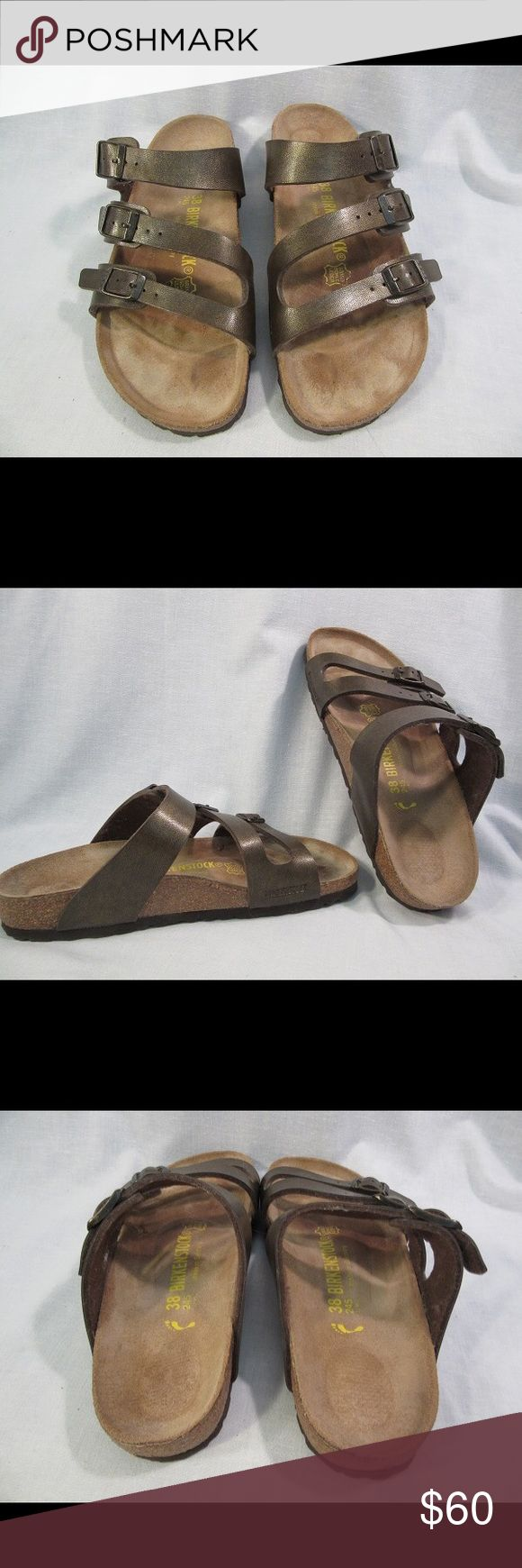 """Birkenstock Gold Bronze Metallic 3 Strap Sandals This pair is metallic """"golden bronze"""" (they were sold as """"gold"""" on QVC but host said they looked more bronze) leather. They have some gold flecks in the color but look more bronze. All 3,straps are adjustable. Closed footprint. I wore them once, onstage behind a podium, while emceeing (I took my heels off to be comfortable) so they were only worn indoors. They looked really great with my metallic bronze and black pantsuit.  Perfect for anytime…"""