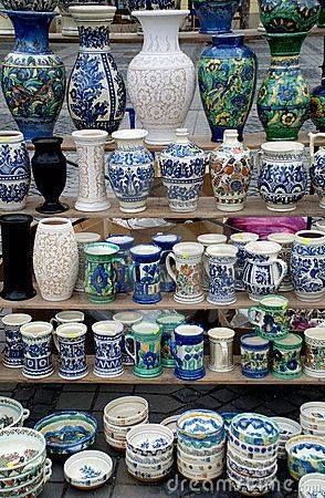 Traditional Romanian handcrafted pottery plates and jugs exposed at a pottery fair from Sibiu