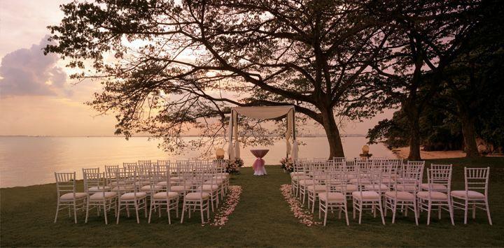 Sunset wedding at Shangri-La's Rasa Sentosa Resort & Spa, Singapore.
