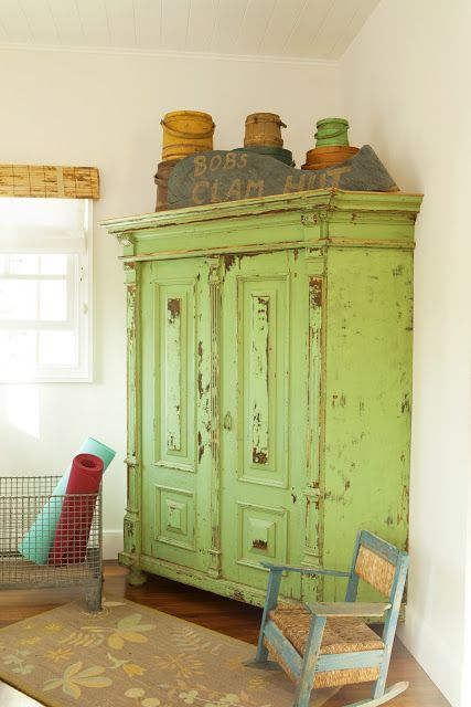 I'm on the lookout for a distressed, big armoire for the living room. In white though.....I do love the green too.