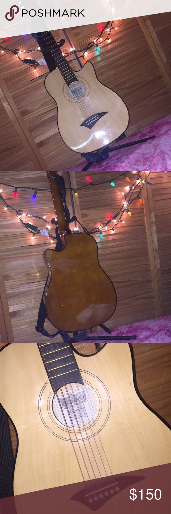 3/4 Jr. Acoustic Guitar Made by: Dean Playmate Comes with a guitar stand and a guitar strap Other