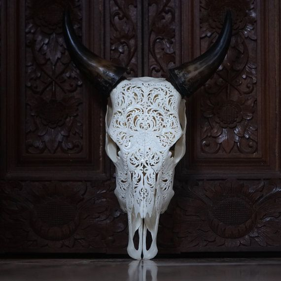 Hand Carved Cow Skull , This Real Cow skull originally from Bali, We collect it from a Local Butcher shop From cleaning and carving took more than a week, we dont just produce , art is about passion. Most of our products carved in Balinese style pattern, Just like how we decorating our stone temple. Every skull might slightly different on size or weight, because its nature Measurement, Height : approx. 50cm - 65cm Width : approx. 46cm - 56cm Weight : approx. 3-4kg To avoid over charge, ...