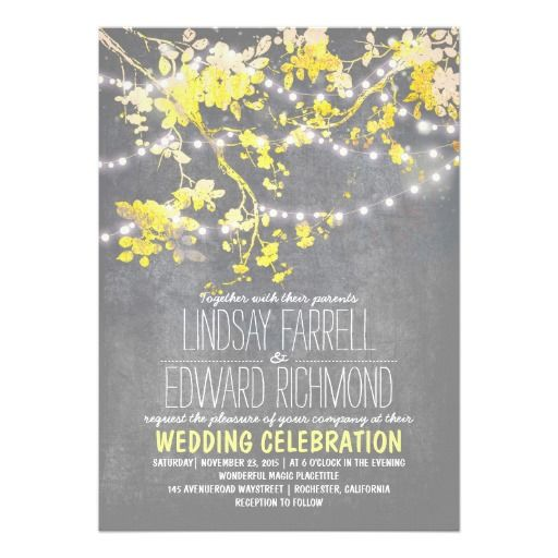 Rustic wedding invitation with sparkly string lights hanging on the blooming tree branches. Shabby and fun stylish typography.