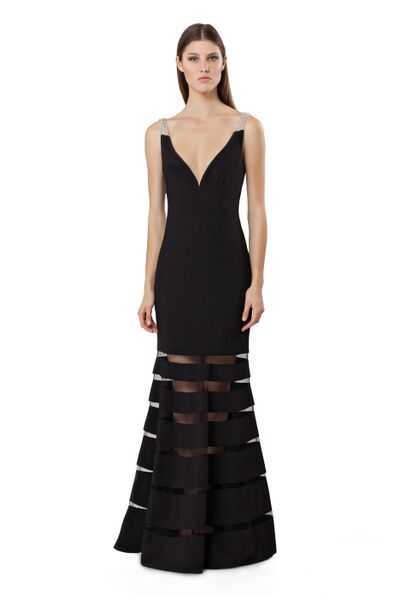Stunning dress by JS Collections ! this dress is elegance and sophistication all in one! Beaded accents on the straps and unique mesh cut outs in the skirt make this dress a must have!