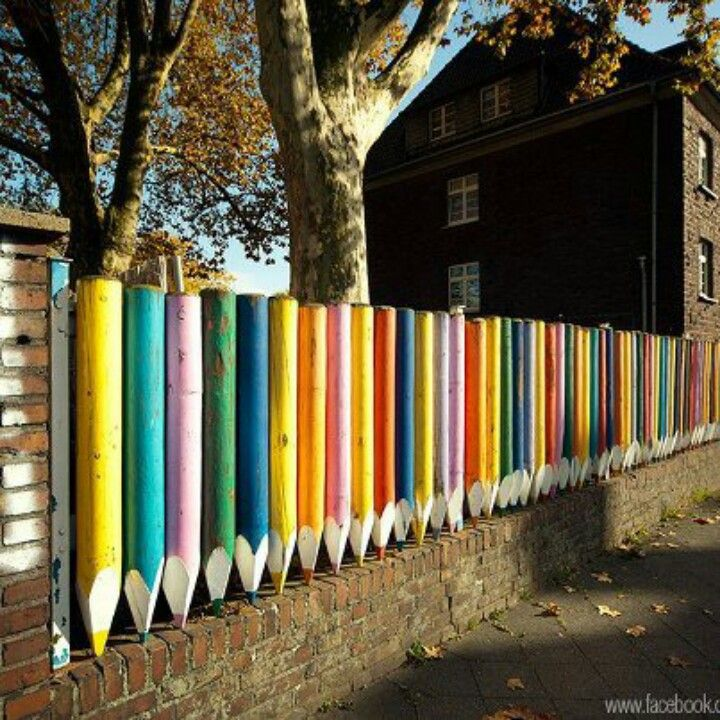 Awesome colorful pencil fence! Great idea for a school or playground!