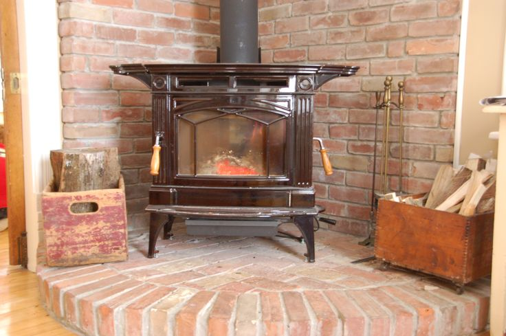 wood stove with brick hearth for corner of living room..but just do floor brick and not backdrop