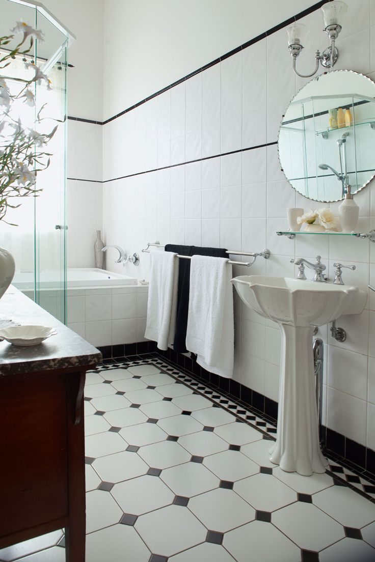 Love the pedestal basin and black and white floors.