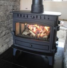 Double sided multifuel stove from local supplier