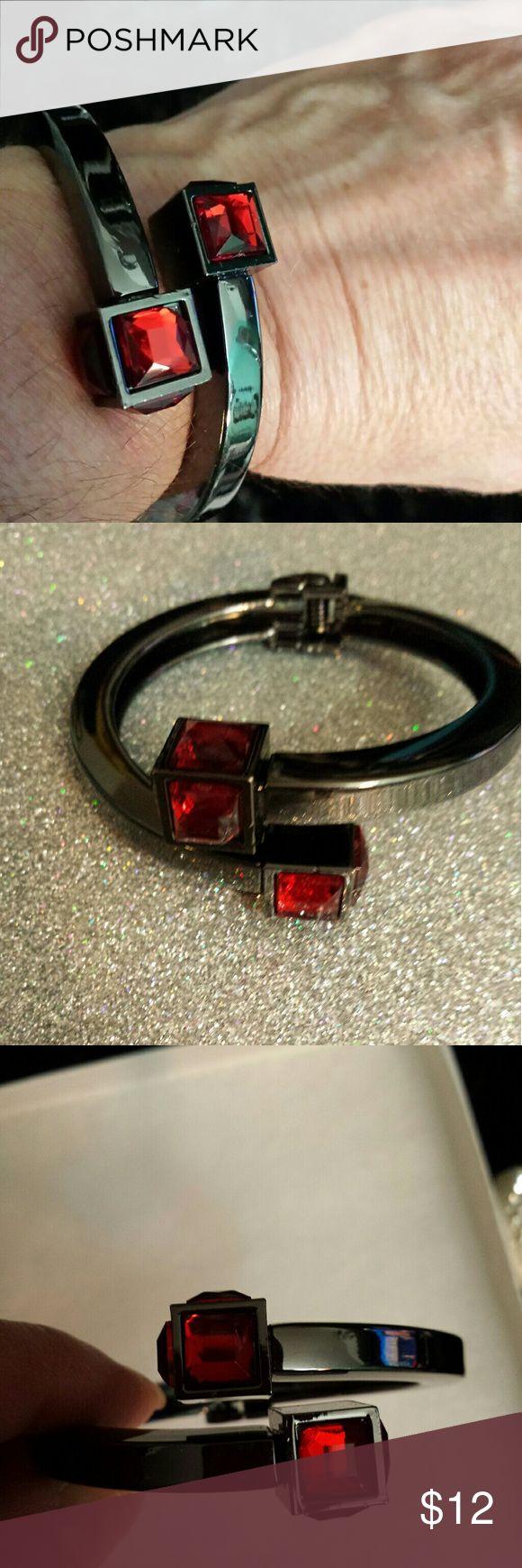 Red rhinestone bracelet Red rhinestones set in dark silver or black metal.  Spring loaded opening. unknown  Jewelry Bracelets