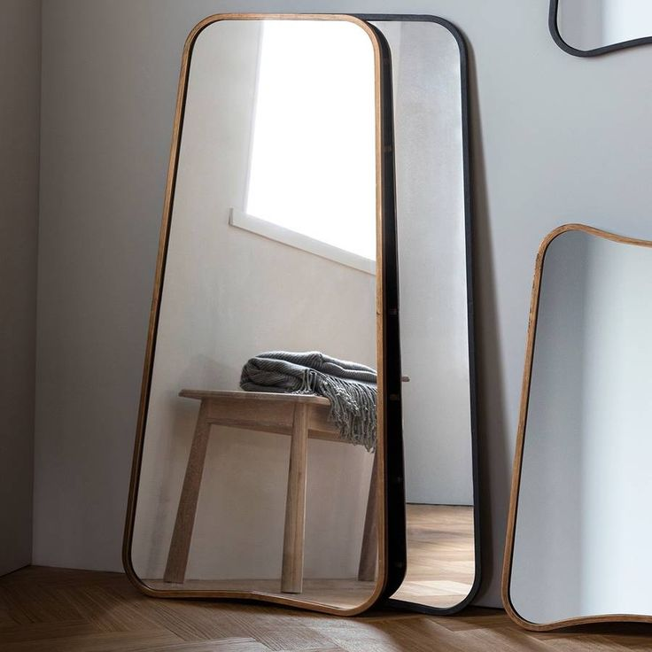 "These are great, curved mirrors, in a choice of black or soft gold.They have a lovely , contemporary curve to them and they come in a choice of two colours and sizes. They look equally good wall mounted as resting as a leaner. They are a good size to make a striking feature and the larger makes a great full length mirror for a bedroom or dressing room.metal and glassW23"" x H48"" - large W24"" x H32"" - small"