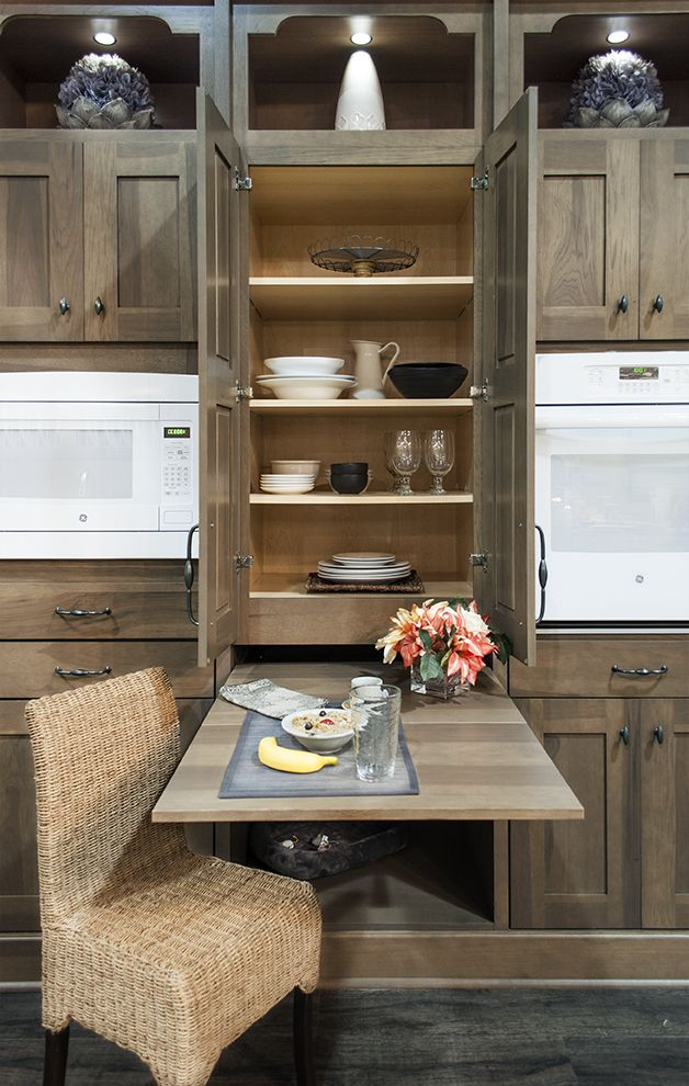 This Pull Out Table is perfect for maximizing space! Check out the cool pet space underneath! #KBIS2015 #wellborncabinet
