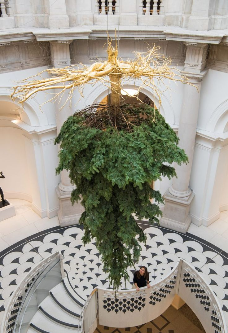 London's Tate Britain has celebrated the start of the festive season by hanging a Christmas tree upside down from its ceiling.