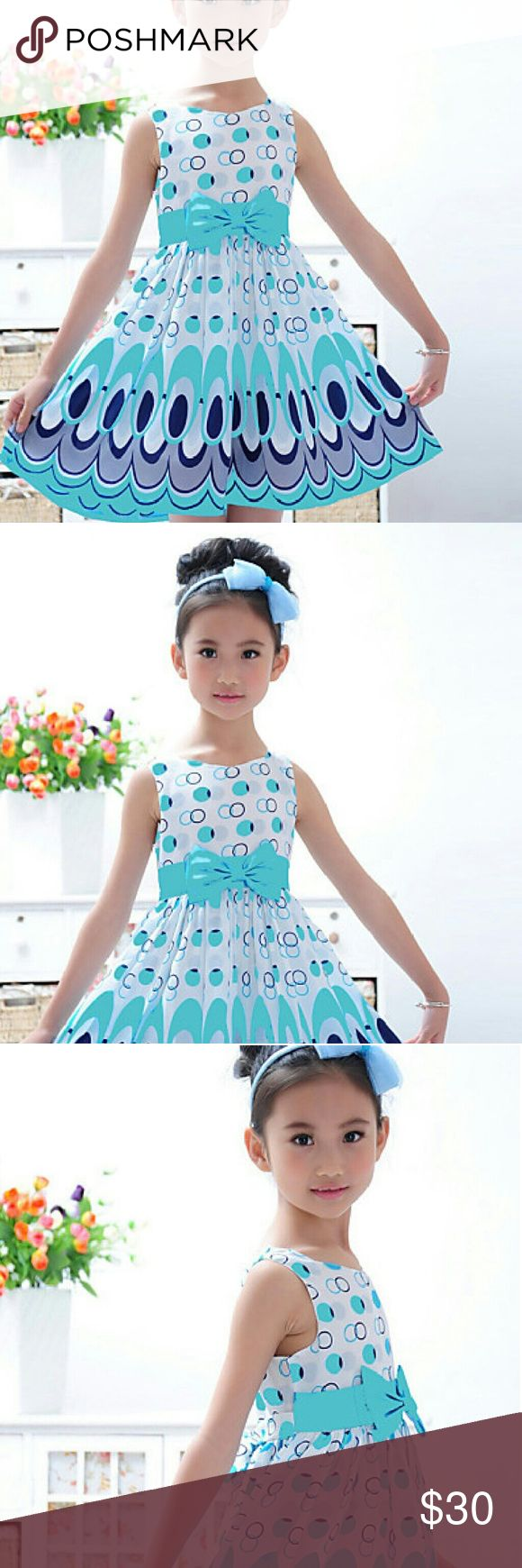 A Fabulous Girls Dress A very lovely dress for your Princess ;)!!  It has a lovely blue and white design with circles. It also has the cute bow in the front and straps on the back to tie it . This is a dress ready for any season and made out of cotton material and knee length.  With this cute dress, your Princess will certainly stand out with flair!! The Clothing lenght is 62cm, Shoulder width is 24cm and the Bust is 60cm. The size is 7T but honestly a 6yr old going on 7 could fit this ;)…