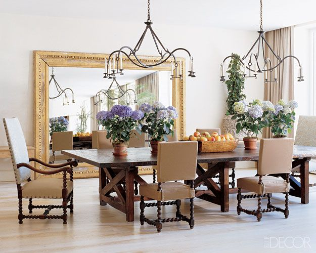 The Giant Gilded Mirror Gives The Dining Room A Grandiose Look.