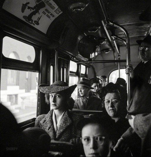"""April 1943. """"Baltimore, Maryland. Crowded bus carrying people to work at 8 a.m."""" Photo by Marjory Collins for the Office of War Information."""