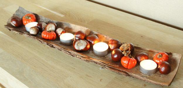 Herfst Decoratietips: minipompoentjes vanuit de doe-het-zelf gecombineerd met kastanjes