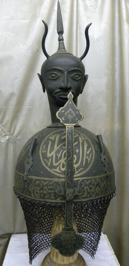 OTTOMAN /TURKISH ISLAMIC WARRIOR DEMON DEVIL FACE HORN HELMET [TC/302] A true unique magnificent Ottoman Turkish Islamic Persian empire khula khud battle warrior Demon Devil face and horn helmet . The Turkish Ottoman soldiers use to wear turbans and as such this helmet is larger than usual helmets.