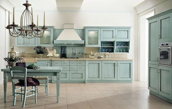 Cottage Style.  Beautiful color on cabinets...