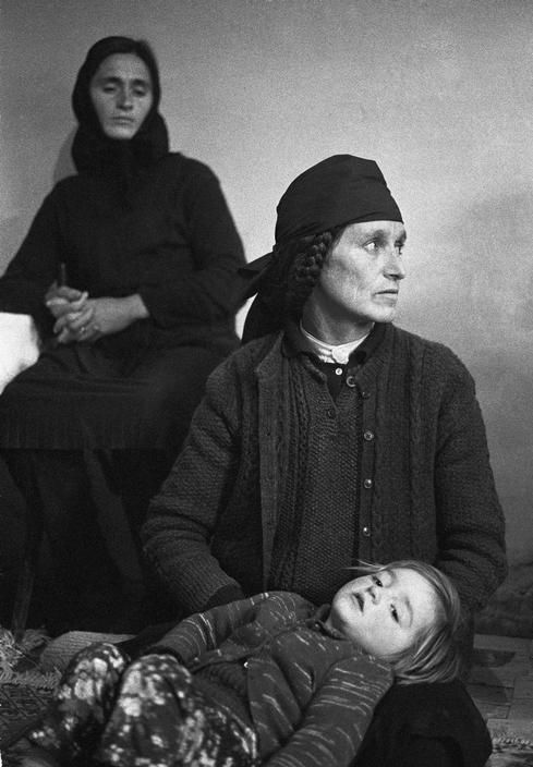 "ALBANIA. Mirdita region. Perlat village. The DONDA family ""forgave"" the blood and has reconciliated with the SULEYMANIS. But the women still mourn the recent deads. 1998"