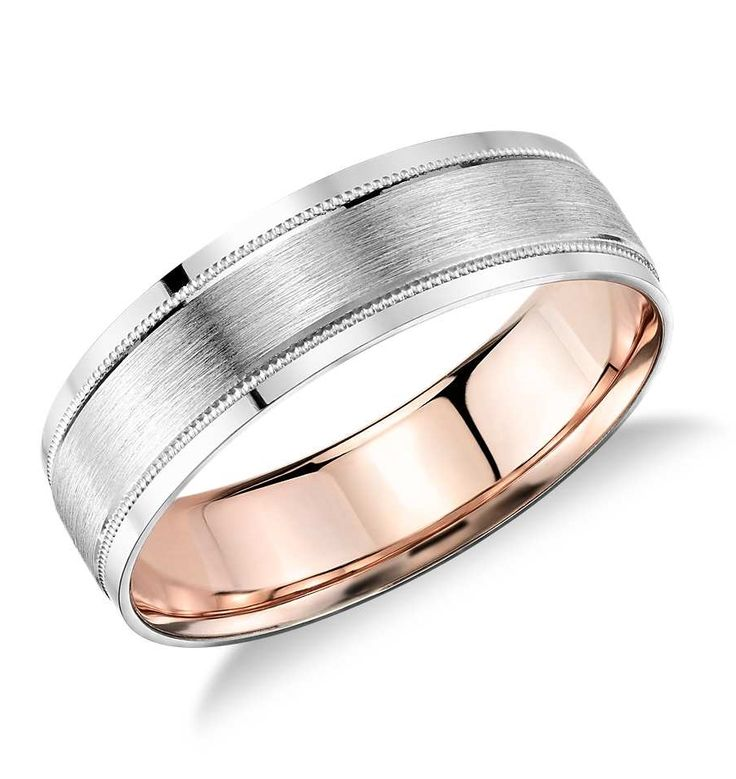This unique platinum men's wedding ring showcases an 18k rose gold interior accent, framed by polished edges, and milgrain detailing.
