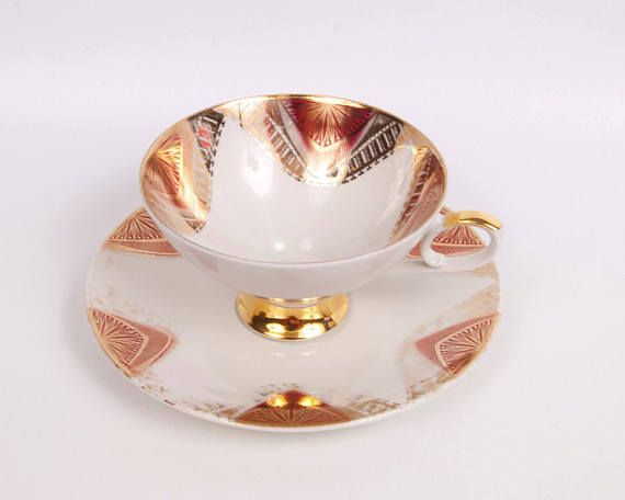 Antique Mitterteich Bavaria Tea Cup Saucer German Gold Pink Footed Teacup Made in Germany Teaparty Stunning Mitterteich Bavaria teacup and saucer. The set is German Porcelain with a gold and pink (raspberry) ornate design. The mark on the bottom of each of the teacup and saucer was