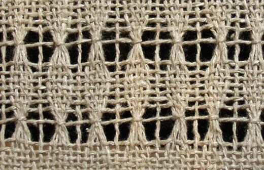 Brooks bouquet was popularized by weaving teacher Marguerite Brooks.  It is an open-shed technique, which means Brooks bouquet lace is created in the weaving when the shed is open.  The bouquet-like effect is achieved when the weft, while passing through the shed, comes out through the top of the warp and wraps around a small number of warp ends before re-entering the shed.  By combining plain weave and Brooks bouquet, small elliptical shapes are created, surrounded by open areas.
