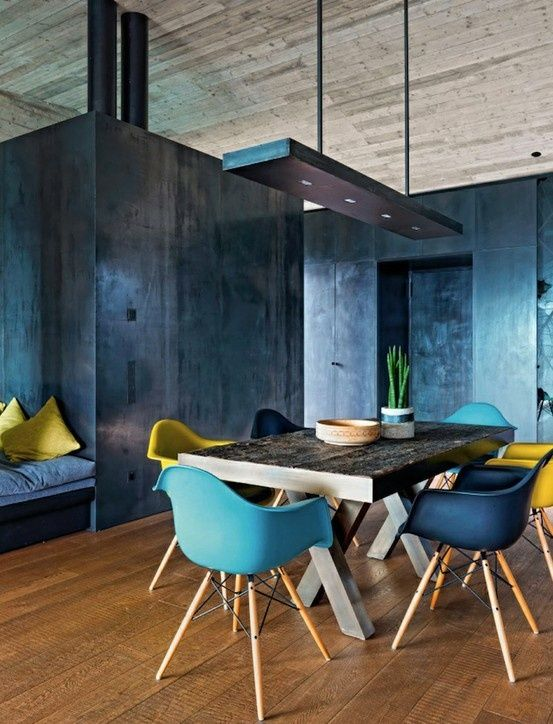 blue on blue dining room, deep blue walls + bright blue Eames chairs