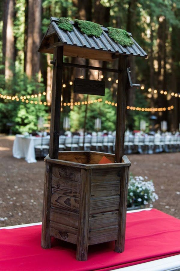 Wooden wishing well for holding wedding cards.  How cute - 19 Wedding Gift Card Box Ideas. See more at http://blog.myweddingreceptionideas.com/2016/01/19-wedding-gift-card-box-ideas.html