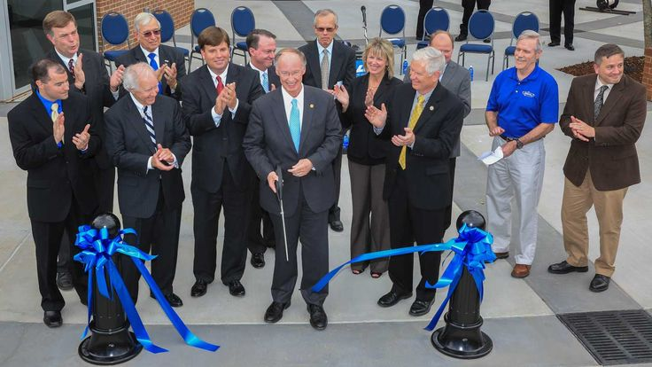 Alabama Governor Robert Bentley, UAH President Robert Altenkirch and other dignitaries cut the ribbon officially opening the Severe Weather Institute and Radar & Lightning Laboratories. (SWIRLL) building Oct. 2, 2014 at 3 p.m. in Huntsville, Al. The facility is located at 4801 Bradford Drive, Huntsville Alabama behind the Cramer Research Hall on the UAH campus. Michael Mercier | UAH