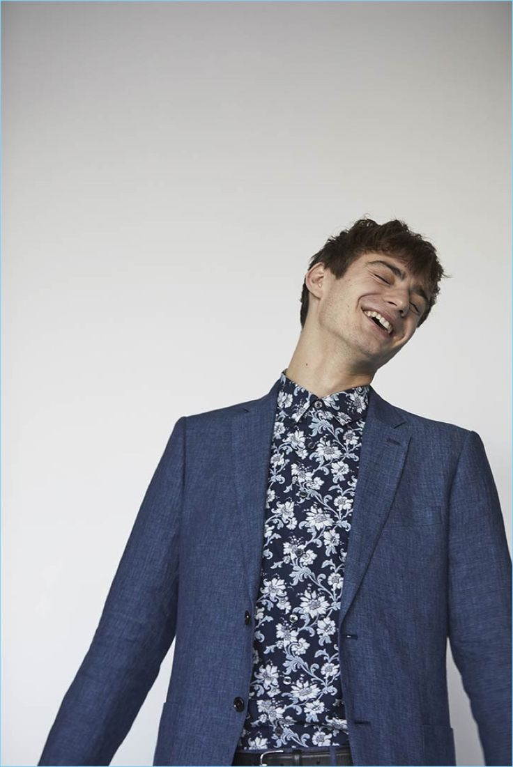 All smiles, Ben Allen sports a floral print shirt and blue blazer for Club Monaco's spring-summer 2017 campaign.