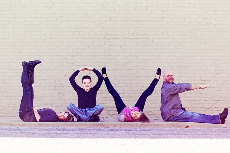 Family of four fun creative portrait pose - family picture ideas -