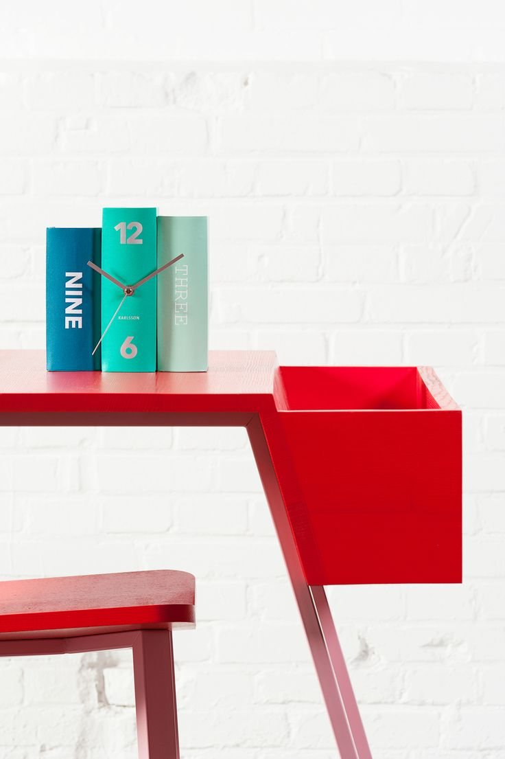 Table clock 'Book pastels paper' designed by Sjoerd van Heumen. A perfect disguise on any bookshelf!