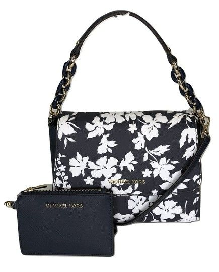 5d56f1ae7ec426 Save big on the Michael Kors Sofia Sm Bundled with Wallet Navy/White Floral Leather  Satchel! This satchel is a top 10 member favorite on Tradesy.