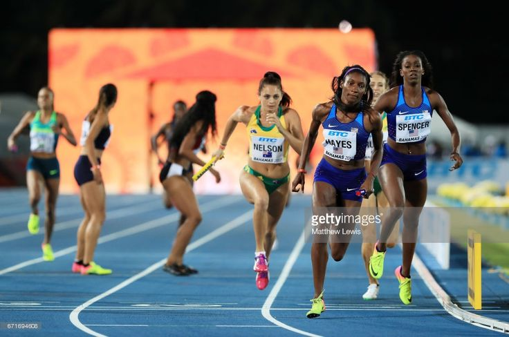 Ashley Spencer hands off to Quanera Hayes of team USA in heat one of the Women's 4 x 400 Meters Relay during the IAAF/BTC World Relays Bahamas 2017 at Thomas Robinson Stadium on April 22, 2017 in Nassau, Bahamas.