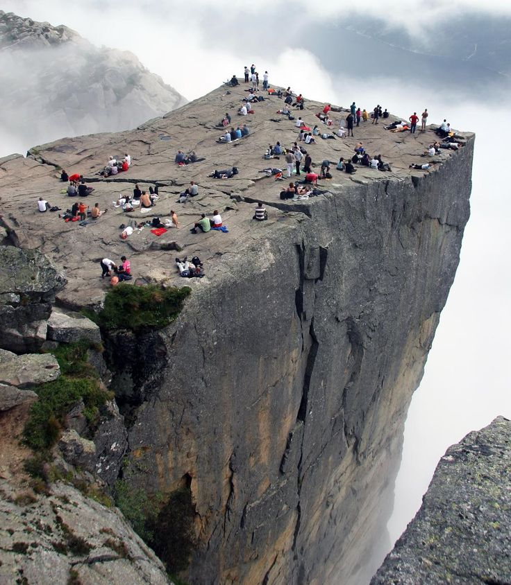 One of the most famous tourist attractions in Norway, this massive 604 meter (1982 feet) tall cliff in Forsand, Norway is known by any of these five names: Preikestolen, Prekestolen, Preacher's Pulpit, Pulpit Rock or Hyvlatonnå. Those who make the steep 3.8 km (2.4 mile) trek are treated to an amazing view over the Lysefjord. There is a lodge and a youth hostel nearby, and more accommodation can be found an hour away in the city of Stavanger.