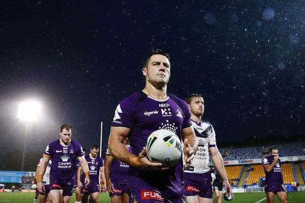 Cooper Cronk Photos Photos - Cooper Cronk of the Storm walks back to the dressing room with the team under the wet condition prior to the round two NRL match between the New Zealand Warriors and the Melbourne Storm at Mt Smart Stadium on March 10, 2017 in Auckland, New Zealand. - NRL Rd 2 - Warriors v Storm