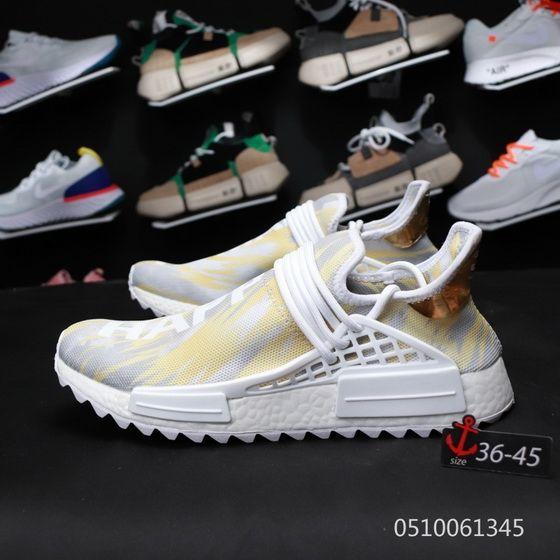 cdb378b12e5 Pharrells Adidas NMD Human Race China Exclusive F99762 Gold Happy ...