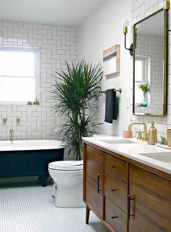 Reclaimed cabinet console, sleek gold fixtures, Parisian mirror + minimal L sconces