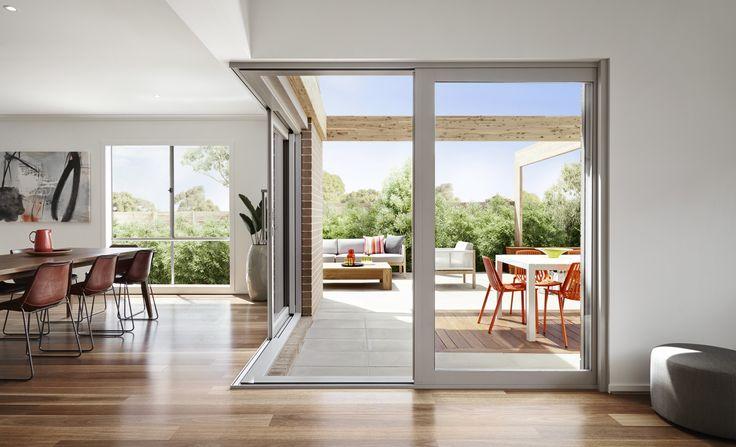 Solid looking A&L corner sliding doors. Indoor / outdoor room.